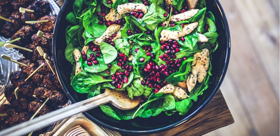 a spinach, cranberry and chicken salad: part of a whole food diet