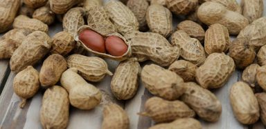 Peanuts on a wooden table.