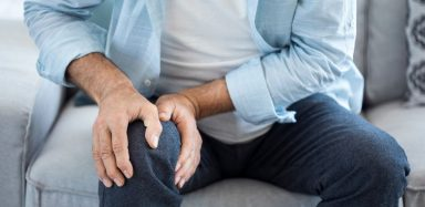Someone experiencing osteoarthritis knee pain.