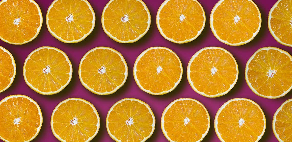 Orange slices on a purple background