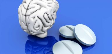 A graphic of a brain and pills.