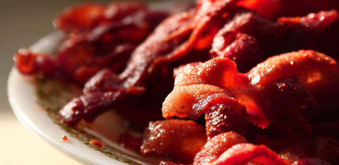 A plate of fried bacon.